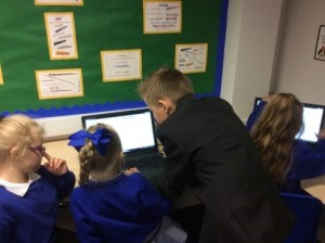 digital leader helping a KS1 pupil